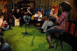 Left to right: Stefanie Eulinberg, Larry Fratangelo, Paradime, Kid Rock, Aaron Julison, Jessica Wagner in a historic, acoustic jam session in the Jungle Room at Elvis Presley's mansion, Memphis, Tenn., November 28, 2011.