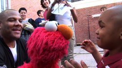 Puppeteer Kevin Clash brings Elmo to visit kids in a scene from the documenta...