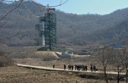 North Korean officials and foreign journalists leave the launch pad after a visit to see the rocket in Tangachai -ri space center on April 8, 2012.