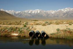 This photo shows pipes conveying water pumped from the Colorado River at the ...