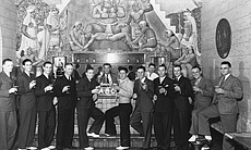 A 1936 championship-winning softball team gathers in the Aztec Brewing Co. rathskeller for a celebratory drink.  Courtesy of San Diego History Center.