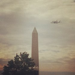 Discovery flies over the Washington Monument