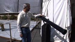 San Salvador project manager Bruce Heyman shows off one of the working guns that will be used for mock gun battles with other tall ships once the San Salvador sets sail.