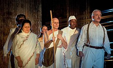 "Maria Zifchak as Kasturbai, Rachelle Durkin (behind Zifchak) as Miss Schlesen, Molly Fillmore as Mrs. Naidoo, Richard Croft as Gandhi, Alfred Walker as Parsi Rustomji and Kim Josephson as Mr. Kallenbach in Philip Glass' unforgettable opera ""Satyagraha."""