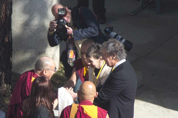 The Dalai Lama Tibetan spiritual leader arrives to San Diego to give two talks, April 18, 2012. He will discuss climate change at University of California, San Diego, then appear at University of San Diego.