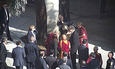 The Dalai Lama is escorted upon arriving to UCS...