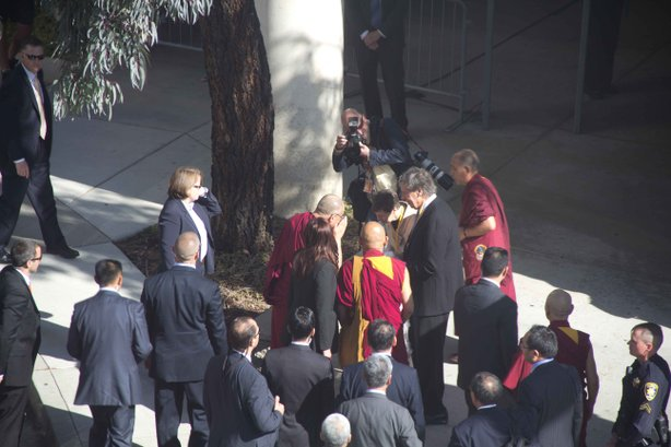 The Dalai Lama is escorted upon arriving to UCSD on April 18, 2012.