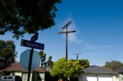 Utility lines await undergrounding at the intersection of Adams Avenue and Je...
