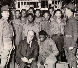 The young men known as the Scottsboro boys with their lawyer, Sam Leibowitz.