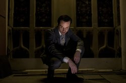 Andrew Scott as as the mousy mastermind of evil, Jim Moriarty, in season two ...
