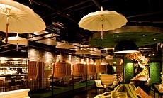 "Interior view of Vin de Syrah in the Gaslamp, designed by Michael Soriano. The basement space is full of playful, whimsical details including ""Magritte inspired"" parasols suspended from the ceiling."