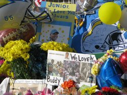 Flowers and signs outside Junior Seau's House in Oceanside