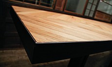 A detail of a table designed by Bells & Whistles for Imig's Kitchen and Bar.
