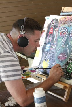 Veteran with PTSD paint as therapy