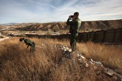 U.S. Border Patrol agents Richard Funke and Colleen Agle look for illegal imm...