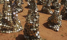 """El Anatsui's """"Peak Project,"""" 1999. Tin, copper, and wire; Installation dimensions variable, each sheet apprxcimately 24 x 48 inches. Installation view, Artist's studio, Nsukka, Nigeria. Collection of the artist."""