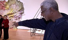 "Artist El Anatsui (right) as featured in the episode ""Change,"" from the series ART IN THE TWENTY-FIRST CENTURY. The program reveals artists at work and speaking in their own words as they demonstrate the power of art to alter perception, challenge convention, and change how we see the world around us."