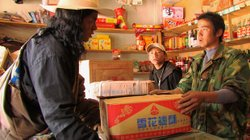 Locho negotiates with a Chinese shopkeeper.