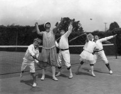 Dodo as a little girl, learning to play tennis with her brothers