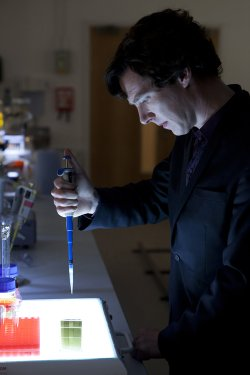 Benedict Cumberbatch as Sherlock, in the lab.