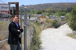 Anthony Wagner stands at the site of a future development along the San Diego River that's raised traffic and environmental concerns.