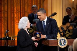 Eunice David accepts the 2012 Library of Congress Gershwin Prize for Popular Song from President Barack Obama on behalf of her husband Hal David, in the East Room of the White House, May 9, 2012.