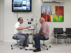 Walt Michaels of Las Vegas receives an eye exam in a Mexicali ophthalmology office.