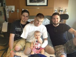 Staff Sgt. Travis Mills with daughter Chloe and friends