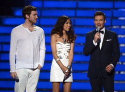 Finalists Phillip Phillips and Jessica Sanchez with host Ryan Seacrest speak ...