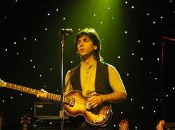 Ardy Sarraf as Paul McCartney from The Fab Four.