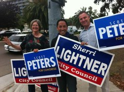 Sherri Lightner, Todd Gloria and Scott Peters campaign on Election Day.