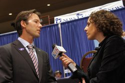 Mark Kersey is interviewed by KPBS reporter Katie Orr at Golden Hall about th...
