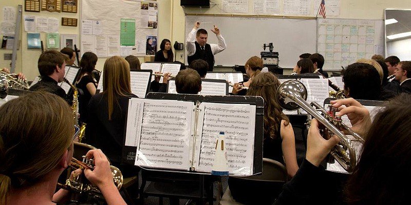 Cameron Brown warms up the University City High School band before a performa...