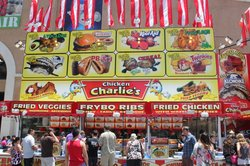 A crowd forms to feast on fried foods at the San Diego County Fair at the Del Mar Fairgrounds.