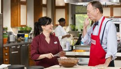 Test cook Yvonne Ruperti and host Christopher Kimball taste chocolate pudding.
