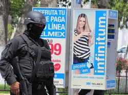 State police from Tamaulipas, Mexico patrol the main plaza in the city of San Fernando.