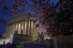 A security officer walks along the west front of the U.S. Supreme Court Building on March 28, 2012 in Washington, DC.