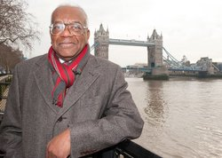 Sir Trevor McDonald in front of Tower Bridge, London.