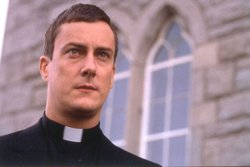Tompkinson as Father Peter Clifford from the television series BALLYKISSANGEL.