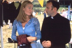 Victoria Smurfit as Orla and Don Wychereley as Father Aidan O'Connell from the television series BALLYKISSANGEL.