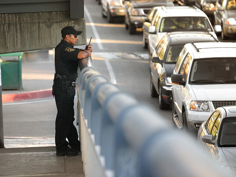 A police officer patrols the border crossing in Tijuana.