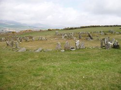 Part of the Manx Heritage Trail, the Braaid is the site of an ancient Celtic-Norse era community. Remnants of a roundhouse in the foreground, c. 650 A.D. and remnants of two longhouses in the background, c. 950 A.D. can be seen here situated on the rolling hills of Marown in central Isle of Man.