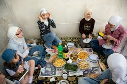Teacher Anan's class has a picnic in the courtyard at Al-Zahra Mosque.