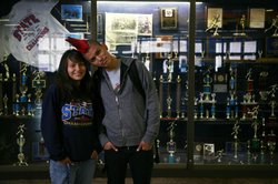 Thomas and Tamara in front of the Navajo Pine Trophy Case.