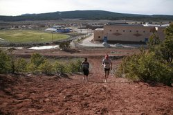 Tamara and Thomas run up Heartbreak Hill, an arduous stretch on the cross-country course.