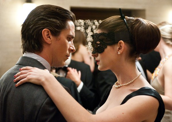 "Christian Bale and Anne Hathaway as Bruce Wayne and Selena Kyle in ""The Dark Knight Rises."""