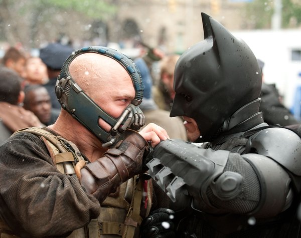 Face off: Tom Hardy's Bane takes on Christian Bale's Batman and we do wonder who will actually win.