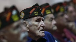 Members of the Veterans of Foreign Wars look on Monday as President Obama spe...