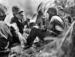 Soldiers at battle, Saipan, 1944.