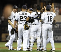 San Diego Padres players high-five after beating the Chicago Cubs 2-0 in a baseball game at Petco Park on August 6, 2012 in San Diego, California.